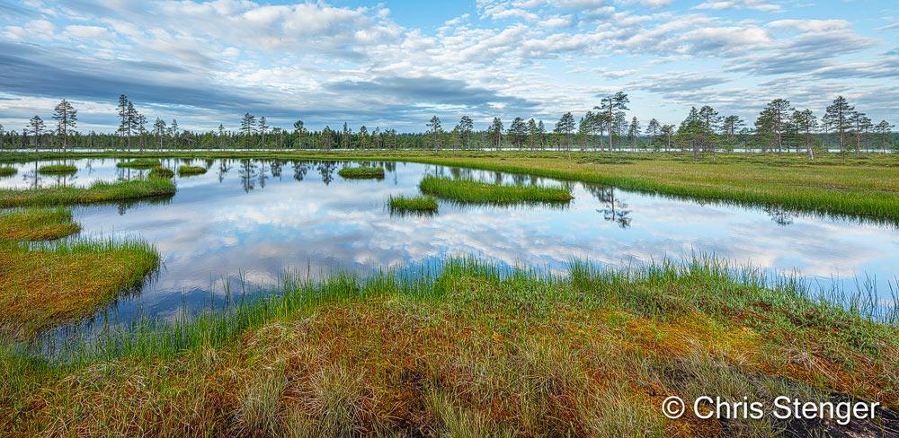 Dit landscap met bossen, meren en moerassen fotografeerde ik in de buurt van Funäsdalen in het zuiden van Zweden